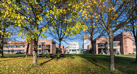 Kristiansand, Norway - November 5, 2017: The exterior of the University in Kristiansand, UiA. Trees in the front. Editorial