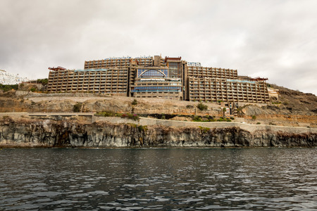 Amadores, Gran Canaria in Spain - December 16, 2017: Gloria Palace hotel, seen from the sea. Cloudy sky.