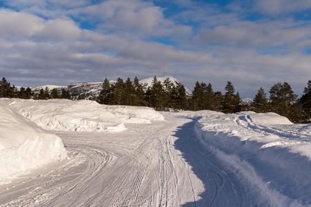 Parking lot in winter, snowdrift from the snow plough, at Jarnsverk Parking in Brokke. Setesdal, Norway