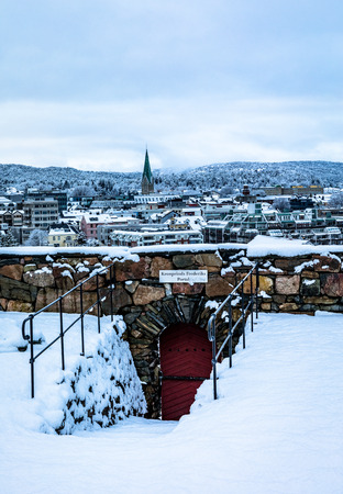 Kristiansand, Norway: Winter in Kristiansand City. The Crown Prince Frederiks gate at Odderoya in front, Kristiansand city in the background. Snow covered city seen from Odderoya.