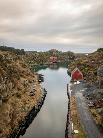 The Rovaer archipelago in Haugesund, in the norwegian west coast. The small canal between the two islands Rovaer and Urdt. Rovaer is a small group of islands, with only around 110 inhabitants. The bay with ferry terminal and a small grocery store.