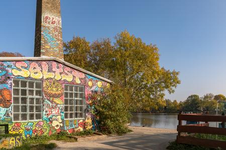 COPENHAGEN, DENMARK - October 2018: Building with grafitti by the canal in Freetown Christiania, a self-proclaimed autonomous neighbourhood in Copenhagen.