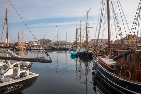 Holbaek, DENMARK - October 2018: Beautiful old sail boats lying at the bay in Holbaek, a small town in Zealand, Denmark. Editöryel