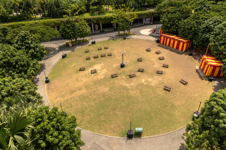 Aerial view of a circular festival site in Gardens by the Bay in Singapore. Round lawn with benches. Editöryel