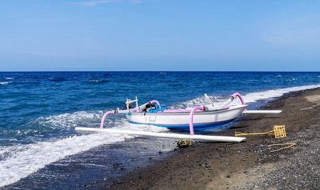 Jukung, the traditional Balinese fishing boat, at the beach in Amed. Bali, Indonesia Stock Photo