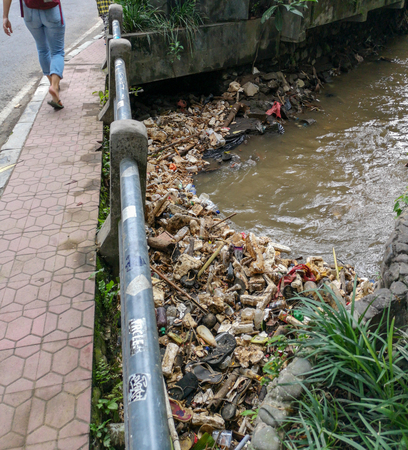 Rubbish floating in a river in the city of Ubud, Bali in Indonesia.