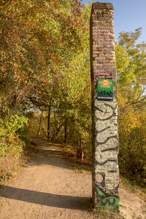 COPENHAGEN, DENMARK - October 2018: Sign on the pillar saying in Danish: Musikfrit område, her spiller naturen. Meaning Music Free Area, Nature Plays Here. Bird area close to Freetown Christiania.