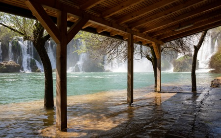 Bosnia and Herzegovina, april 2019: Kravice waterfall seen from inside the pavilion by the Trebizat river