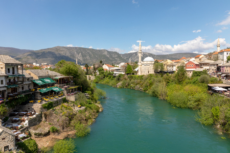 Mostar, Bosnia and Herzegovina - april 2017: Nerteva River and Old City of Mostar, with Ottoman Mosque