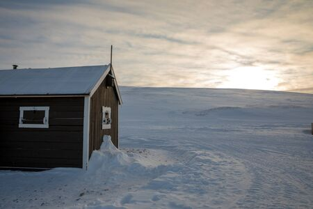 A small cabin in winter landscape at Svalbard