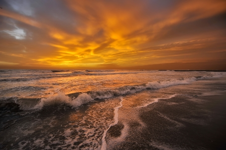 The setting sun behind the clouds on the sea of orange colors everything Stock Photo - 15886262
