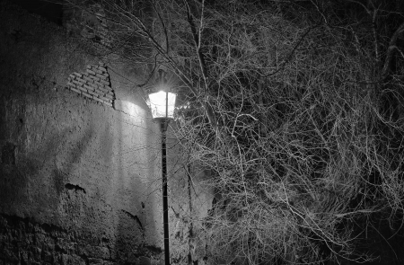 Street lamp near an ancient wall in Rome Stock Photo