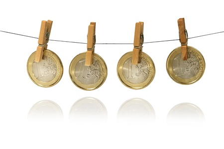 One Euro coins hanging on clotheshorse Stock Photo - 17724056