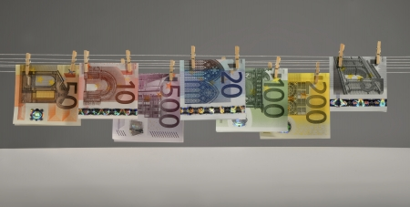 all kinds of Euro banknotes hanging on clotheshorse Stock Photo - 17724070