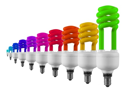 Green energy saving light bulb with multicolour one's isolated on white