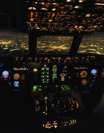 panel: Cockpit snapshot while flying over Madrid Stock Photo