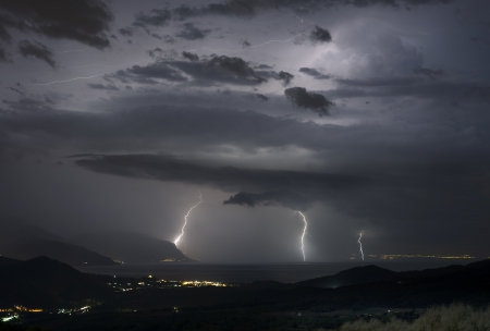 Heavy thunderstorm at night in southern Italy photo