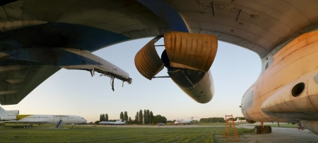 Abandoned aircrafts lighted from the warm light at sunset