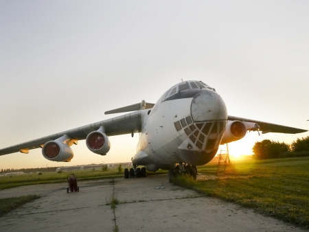 Abandoned russian aircrafts lighted from the warm light at sunset