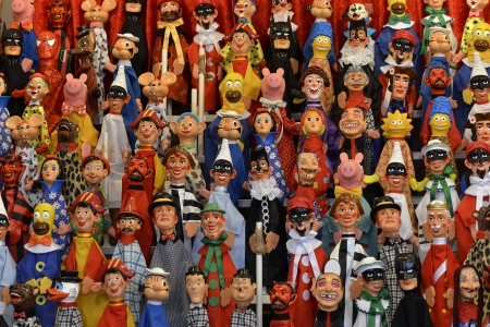 Many hanging puppets of all colors