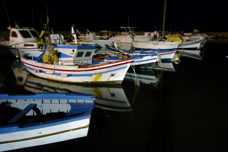 Fishing boats in the harbor at night Stock Photo