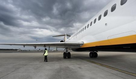 Pilot conducting an aircraft external inspection Stock Photo