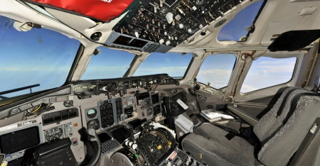 Cockpit snapshot while flying with empty seat of first officer Stock Photo