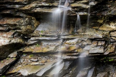 Small waterfall between the rocks Stock Photo