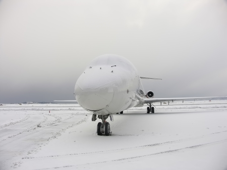 Line plane parked covered by snow Stock Photo