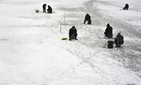 Group of fishermen on the ice Stock Photo