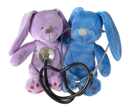 Two teddy bears with stethoscope in the shape of heart