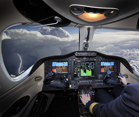 A beautiful view of a thunderstorm from the cockpit Stock Photo