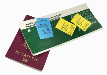 Old airline ticket with baggage tags and italian passport Stock Photo