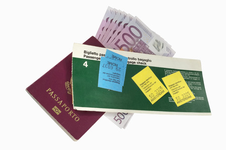 Old airline ticket with baggage tags, italian passport and euro banknotes Stock Photo