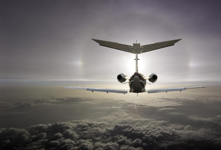 An executive aircraft flying int the optical effect Stock Photo