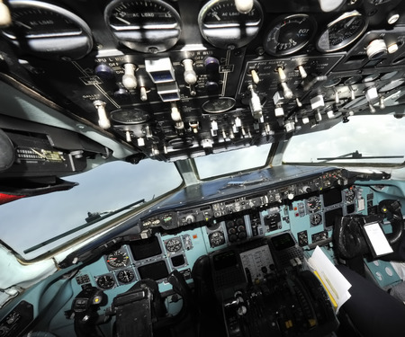 The cockpit of an old plane flying Stock Photo