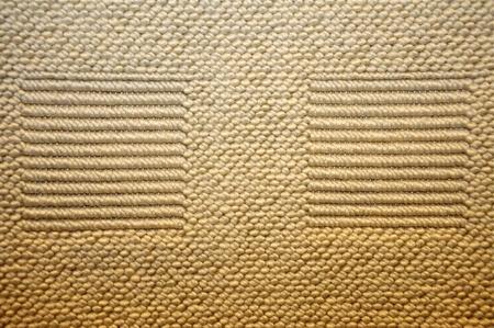 textile image: Brown woolen woven carpet texture or background