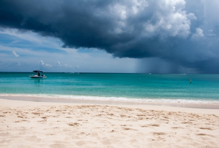 storm coming: Gorgeous Tropical White Sand Beach in the summer with storm coming