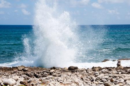 Blow holes in rocks on the ocean shore