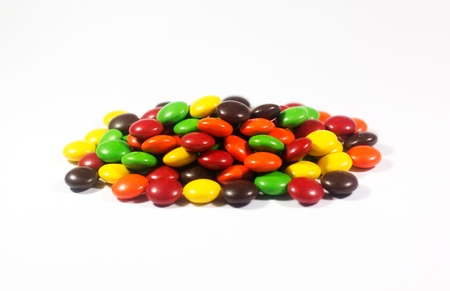 obesity kids: Coated Chocolate Isolated in White