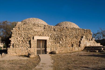 ancient turkish hammam against blue sky photo
