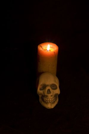 Candle and skull against black Stock Photo - 3499144