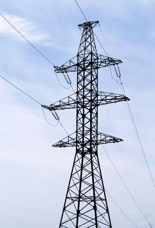 volts: Electricity pylon against blue sky
