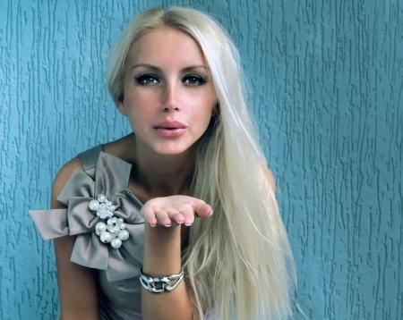 air kiss: Blond girl sending air kiss