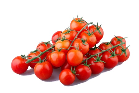 Three branches of small tomatoes cherry  isolated over white background