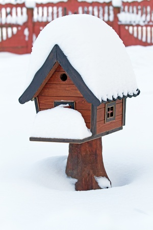 Bird s house in snowdrift Stock Photo - 16887800
