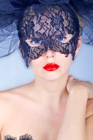 Portrait of beautiful woman in mask photo
