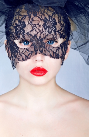 Portrait of a young beautiful woman wearing mask photo