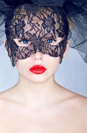 Portret van een jonge mooie vrouw die masker Stockfoto