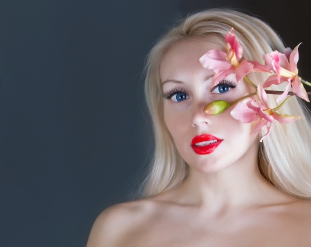 Portrait of  a beautiful woman with orchid photo